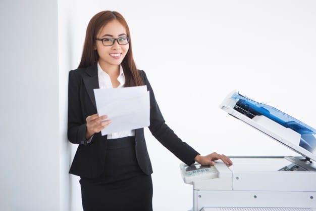 membuat copy dokumen dengan mesin fotocopy